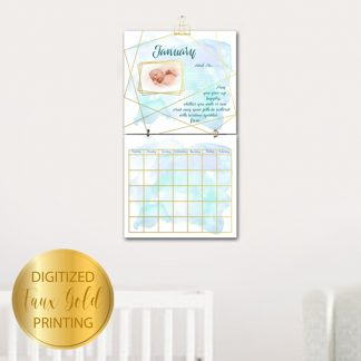 Geo-Gold-Baby's-First-Year-Calendar-hanging-on-wall-photo