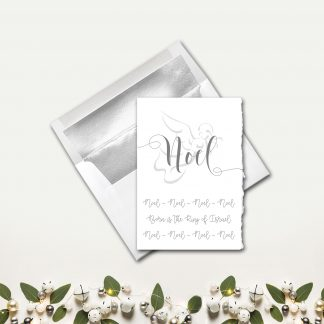 Noel-Torn-Edges-Card-Front-and-Silver-Lined-White-Envelope-Christmas-leaves-and-bells-flatlay